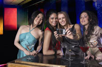 Women taking their photograph at bar