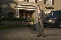 Businessman outside his house with a car