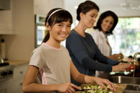 Family preparing meal in kitchen