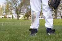 Young boy's dirty baseball uniform