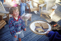 Young boy and family making s'mores