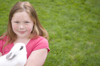 Young girl holding rabbit