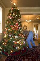 Man setting up Christmas tree