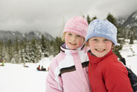 Children smiling in snow
