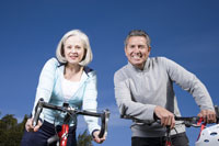Mature couple riding bicycles