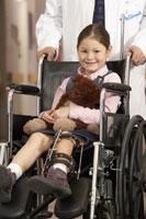 Girl wearing leg brace in wheelchair