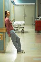 nurse leaning against corridor wall