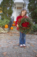 Young girl holding wreath