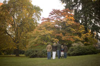 Family standing outdoors in autumn