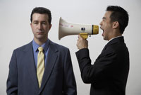 Businessman screaming at co-worker