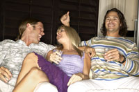 Friends having drinks on sofa