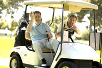 Men relaxing with cigars in golf cart
