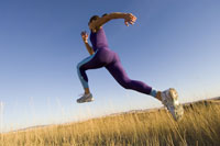 athlete jogging through long grass