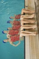 Synchronized swim team practicing