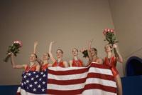 Swim team holding American flag