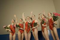 Swim team waving in celebration