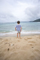 Boy standing on beach in Kauai
