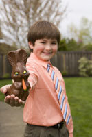 Boy holding chocolate Easter bunny