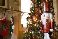 Nutcracker beside Christmas tree