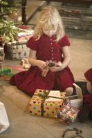 Young girl opening Christmas gift