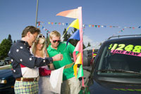 Couple signing contracts to buy used car