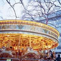 Blurry fairground carousel