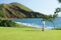 Man playing golf on scenic course