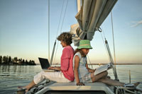 Mother and daughter sitting on boat