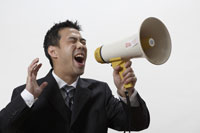 Businessman using bullhorn