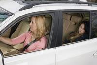 Woman driving teenage daughter