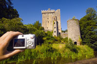 Tourist taking picture of Blarney Castle