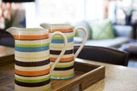 Striped mugs on breakfast tray