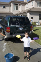 Boy washing car