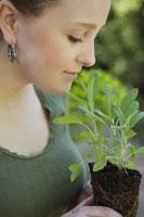 Woman smelling sage plant