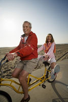 Senior couple riding a tandem bike