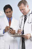 Doctors checking schedule on pda