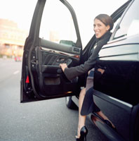 Woman climbing out of car