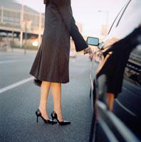 Woman unlocking car door