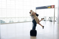Couple hugging in airport