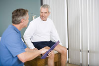 Physical therapist and patient looking