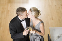 Couple in evening wear kissing