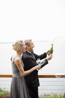 Couple opening champagne