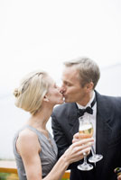 Couple with champagne kissing