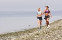 Women jogging on beach