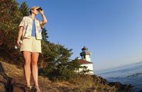 Woman overlooking ocean with binoculars