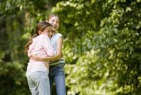Sisters hugging in park