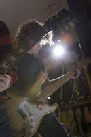 Guitarist playing in recording studio