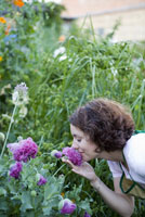 Woman smelling chrysanthemum flower