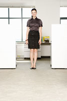 woman standing next to cubicle