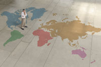 man standing on world map